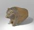 A photograph showing a terracotta pig missing its back legs